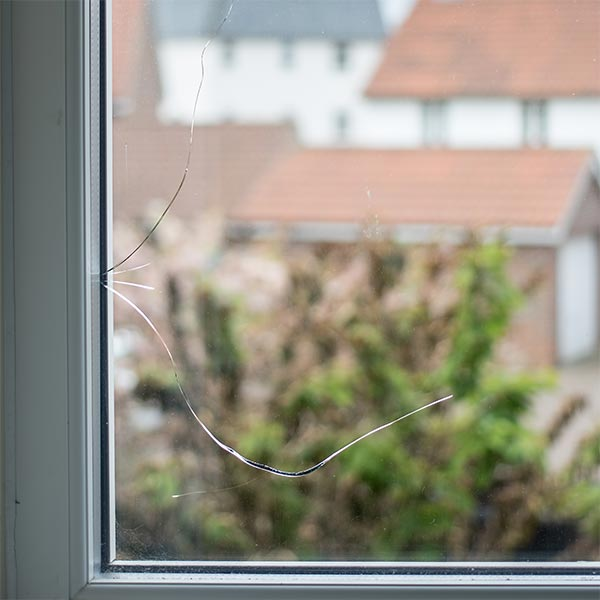 Repair of cracked glass in double glazed unit